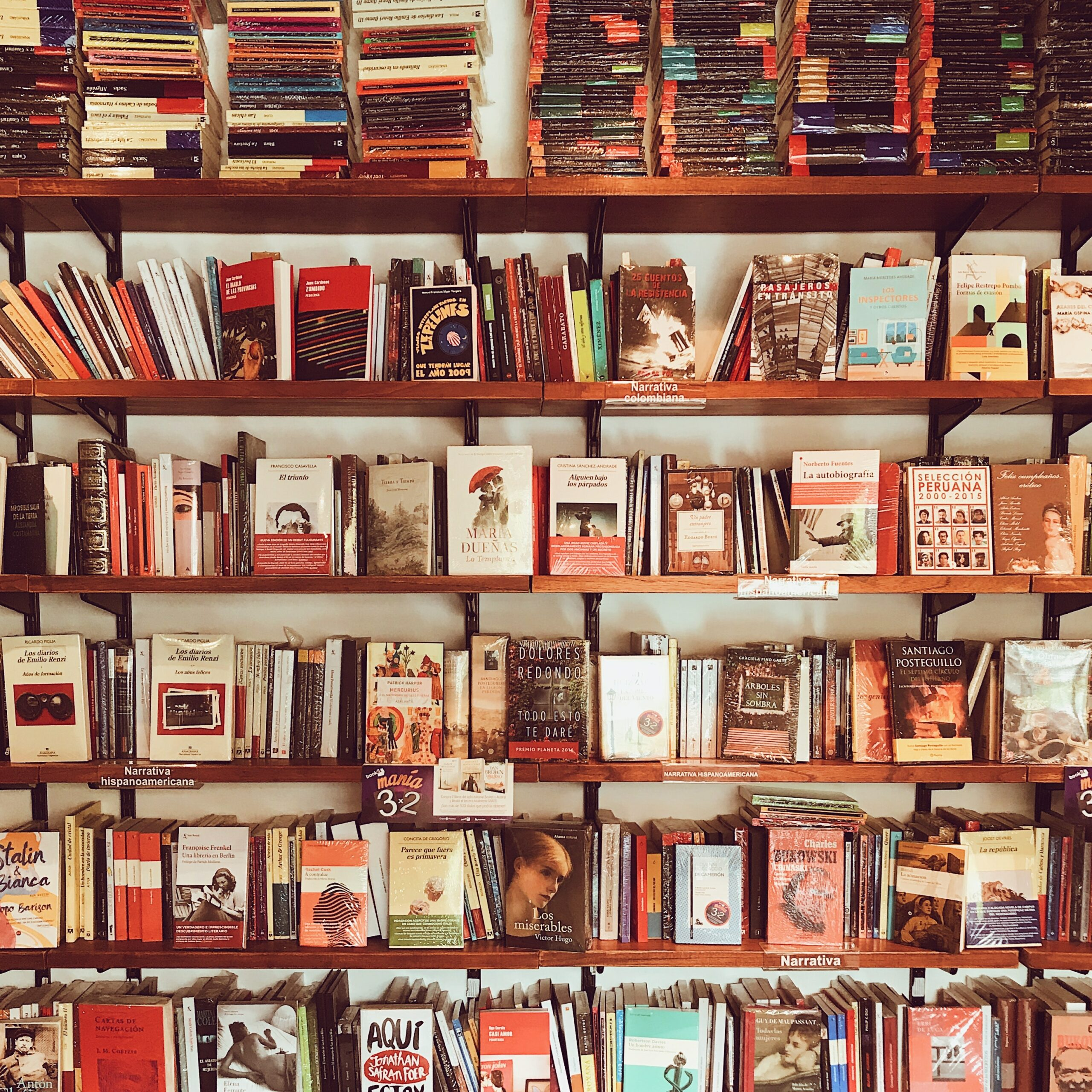 assorted-title-books-on-brown-wooden-shelf-1517355-scaled